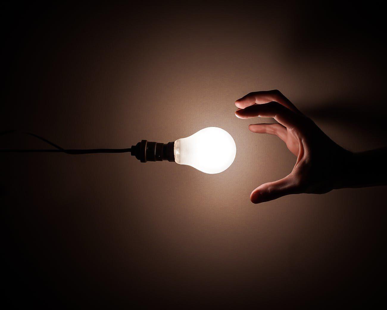 person holding white light bulb