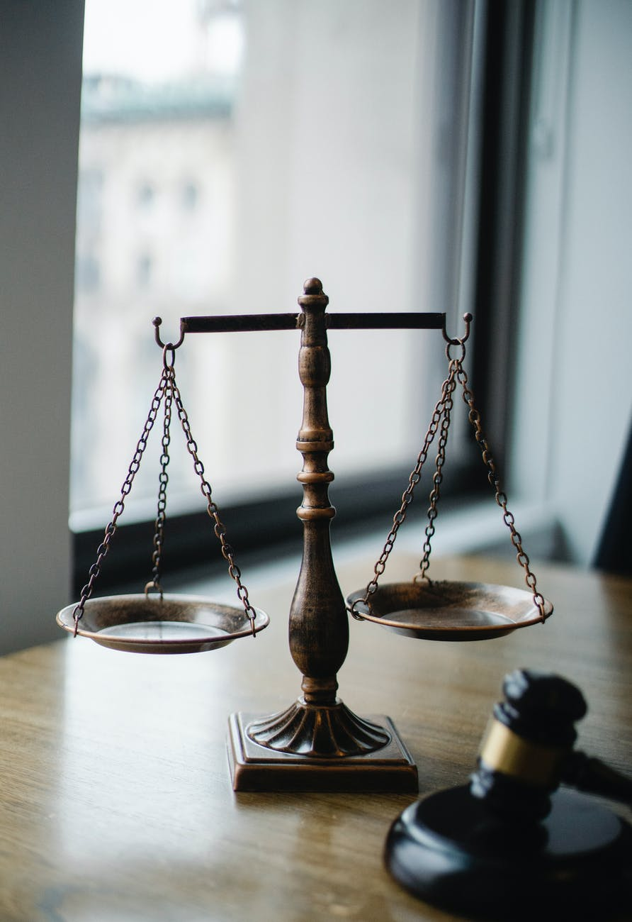 judgement scale and gavel in judge office